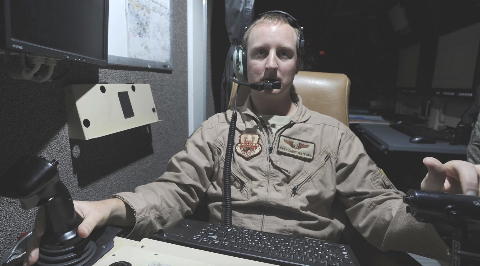 Staff Sgt. Christopher Watford controls the sensors of a MQ-1B Predator drone during a routine mission, August 2010, Joint Base Balad, Iraq (via U.S. Air Force / Senior Airman Matt Coleman-Foster)