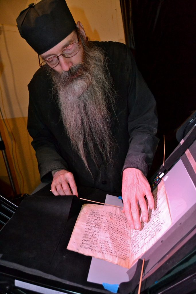 The librarian at St. Catherine's examining an ancient text. MARK SCHROPE