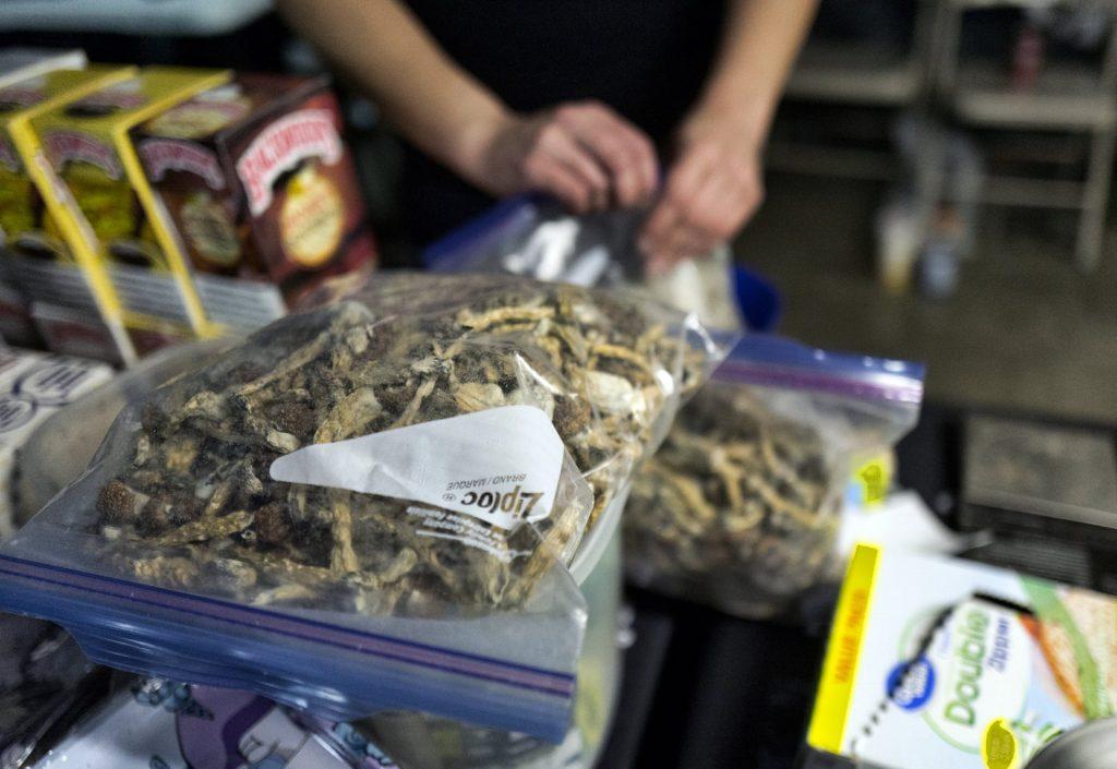 A vendor bags psilocybin mushrooms at a pop-up cannabis market in LA. Photograph: Richard Vogel/AP